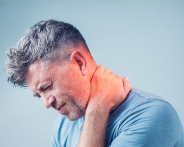 man with neck pain- pain managamant in Gainesville, FL