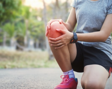 person with knee pain - pain clinic gainesville - regenerative medicine